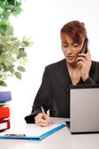 Businesswoman talking on telephone — Stock Photo