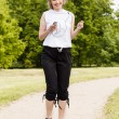 Woman jogging in the park in summer  — Photo