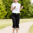 Woman jogging in the park in summer  — ストック写真