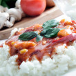 Chicken in tomato sauce with rice — Stock Photo