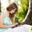 Young woman looking at her tablet — Stock Photo