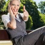 Young woman lifts thumb upwards — Stock Photo