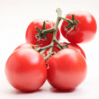 Fresh tomatoes on white background — Stock Photo