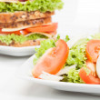 Stock Photo: Salad and sandwiches. Selective focus