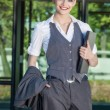 Businesswoman standing at front of office building — Stock Photo #28221037