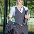 Businesswoman standing at front of office building  — Stock Photo