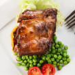 Pork spareribs on plate — Stock Photo #28221687