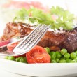 Pork spareribs on plate — Stock Photo #28223037