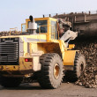 Stock Photo: Yellow bulldozer working