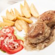 Meatballs with stewed onion and fried potato wedges — Stock Photo #29787129