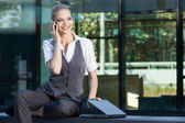 Businesswoman calling on the mobile phone — Stock Photo