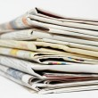 Stock Photo: Stack of newspapers on white background