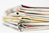 Stack of newspapers on white background — Stock Photo