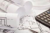 Calculator on architecture blueprints — Stock Photo