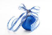 Christmas ball with ribbon — Stock Photo