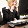 Female executive talking on phone — Stock Photo