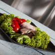 Stock Photo: Raw vegetables and sliced roast