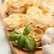 Italian pasta fettuccine nest — Stock Photo #32756533
