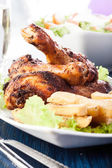 Chicken drumsticks with fries — Stock Photo