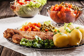 Breaded cutlet and potatoes — Stock Photo