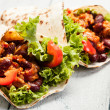 Burrito. Tortilla with meat and beans — Stock Photo #35099055