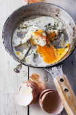 Fried eggs on frying pan — Stock Photo