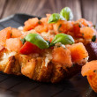 Bruschetta with mozzarella and tomato — Stockfoto