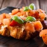 Bruschetta with mozzarella and tomato — Stock Photo