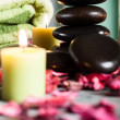 Hot stones essential oil and candles — Stock Photo