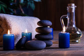 Spa still life with hot stones essential oil and candles — Stock Photo