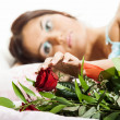 Beautiful woman with a bouquet of roses — Stock Photo