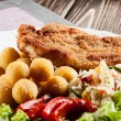 Stock Photo: Breaded cutlet and potatoes
