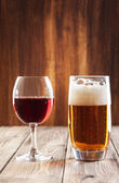 Wine glass and glass of beer — Stock Photo