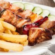 Stock Photo: Grilled shashlik with chips