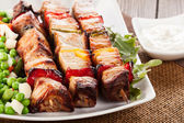 Grilled shashlik with vegetables — Stock Photo