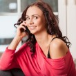 Beautiful young woman using mobile phone — Stock Photo