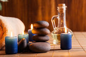 Spa still life with hot stones and candles — Stock Photo