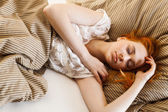 Young woman sleeping in bed — Stock Photo