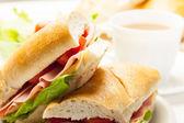 Italian panini sandwich with ham, cheese and tomato — Stock Photo
