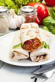 Mexican burritos on a plate — Stock Photo