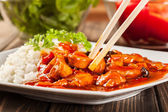 Sweet and sour chicken with rice — Stock Photo