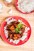 Sweet and sour pork and rice — Stockfoto