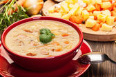 Pea soup with bacon and sausage — Stock Photo