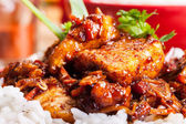 Close-up of sweet and sour pork and rice — Foto de Stock