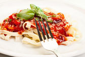 Pasta fettuccine with tomato sauce and basil — Stock Photo