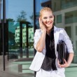 Young businesswoman using mobile phone on street — Stock Photo