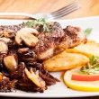 Fried pork chop with mushrooms and chips — Stock Photo #47658805
