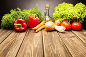 Vegetables on old wooden table — Stock Photo