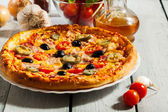 Pizza with bacon, olives and jalapeno pepper — Stock Photo