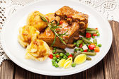 Pork spareribs served with mashed potatoes — Stock Photo